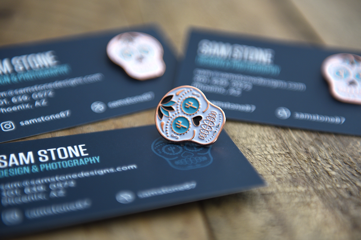 Business card and pin Sam Stone
